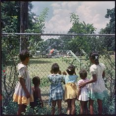 GORDON PARKS Outside Looking in, Mobile, Alabama, 1956 This is another piece protesting how blacks were being treated.  This one is even more effective because you can imagine being one of the children not allowed to go and play on the equipment.