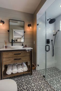 Cement tiles on the floor of this bathroom with an infinity drain.