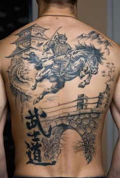 Samurai on horse and a castle tattoo on back