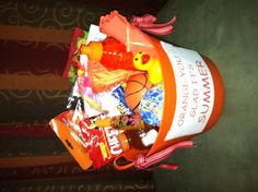 """Last day of school themed gift idea. Everything in basket is orange. """"Orange You Glad It's Summer""""."""