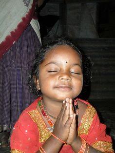 Tribal child praying