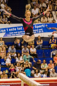 Sandra Izbaşa on beam by Mihai Timaru, via 500px