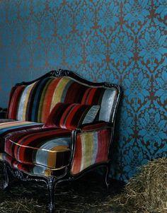 Stripped velvet sofa with damask wallpaper