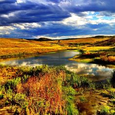 Crystal Valley Ranch, Castle Rock, Colorado — by Dan Rose. #pond #sky good luck catching this again the lighting was perfect, I Live near it and only 1 great shot in 5 years....