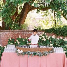 rose bar at wedding with lots of florals