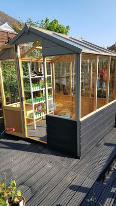 """We think Susan's greenhouse looks brilliant on her decking! Here's what Susan had to say: """"Easy enough to put together with two of us doing it. Good quality. Painted it to match our Log cabin."""""""
