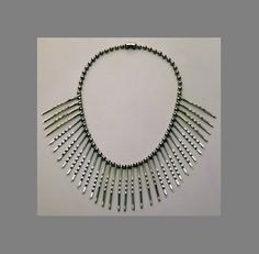 This dramatic necklace uses inexpensive window chain sold on giant wheels at hardware stores and steel bobbi pins. Seeing her necklace, suddenly these objects become BEAUTIFUL and full of unexpected possibilities; our notions of jewelry change.