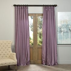 The Smoky Plum Vintage Faux Dupioni silk curtain panel features black tabs and a rod pocket construction. This curtain panel also highlights a cotton poly lining with a flannel interlining.