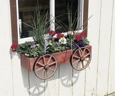 Amish Wagon Wheel Rustic Window Box Planter Pretty up your windowsill with a wagon wheel planter! Amish made outdoor decor. #windowboxes #planters