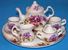 Miniature Porcelain Tea Set, White w Pansies Tray, Teapot w Lid, Sugar w Lid, Creamer, Two Teacups w Two Saucers.
