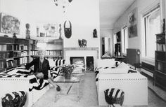 Peggy Guggenheim  in her library with perfect couches for reading