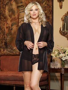 A sexy sheer black chiffon robe that is sure to heat up the night. This kimono style robe is light and flows away from the body. It has lace sleeves and a removable waist tie. The set comes with a matching lace booty short. Available in sizes Small-3/4X