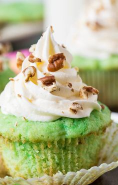 Watergate Cupcakes are a fun, nostalgic dessert flavored with pistachio pudding and pineapple and topped with a marshmallow fluff frosting. Cupcake Flavors, Cupcake Recipes, Cupcake Cakes, Dessert Recipes, Tea Cakes, Cupcake Ideas, Muffin Recipes, Pistachio Cupcakes, Pistachio Pudding