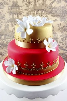 Thai red and gold two tier cake web