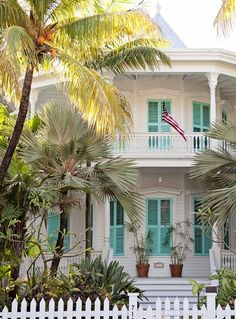 Love the bright turquoise shutters on this classic Victorian Key West villa!: