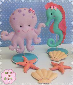 Decoração de mesa em feltro Tema: Fundo do Mar Medidas: Polvo: 20 cm alt x 21 cm larg Cavalo Marinho: 24 cm alt x 12 cm larg Conchinhas e estrelas do mar: 8 cm
