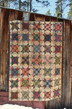 Sister's Paint Box Quilt.  Made with Metropolitan Fair by Barbara Brackman and Paint Box by Laundry Basket Quilts fabrics for Moda.  Pattern is Sister's Choice and the tutorial is found at Bonnie Hunter's website Quiltville.com.