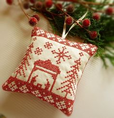 cross stitched nativity ornament on linen