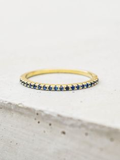 This ring is a gorgeous micro-pave eternity ring. This eternity band is ultra thin and has sapphire cubic zirconia stones covering the whole band. Looks great on on its own or stacked! Gold Plated brass with blue sapphire cubic zirconia. Sapphire Eternity Ring, Eternity Bands, Jewellery Shop Near Me, Vintage Ring Box, Thin Gold Rings, Gold Band Ring, Ring Ring, Fashion Rings, Wedding Rings