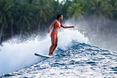 We most often see Kelia Moniz perched delicately on the tip of a longboard, but the girl can ride just about anything. Good times in Indo. Photo: Russi