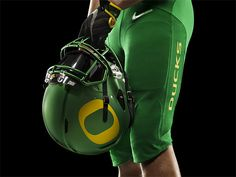 Oregon Ducks bringing out all green uniforms and a beautiful matte green helmet vs Florida State in the 2014 Rose Bowl (first ever college football playoff game).