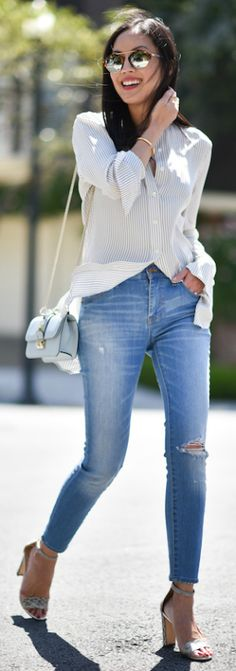 A button up blouse + ultimate choice + smart casual style + stunning summer style + Ann Taylor + super cute + distressed denim skinny jeans + silk button up + pair of heeled sandals + summery finish to the look.   Blouse: Frame Denim, Jeans: Madewell, Bag: Valentino.