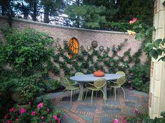 intimate patio - brickwork and espalier