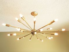 @fetechicago  Magnificent LARGE 24 arm, ceiling-hung Sputnik light!    Light is constructed from brass fixings with each individual part hand brushed to a