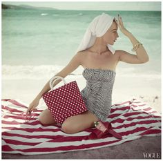 "PHOTO Roger Prigent – ""Model in Strapless Bathing Suit at Beach"" – Condè Nast Archive Vogue May 1954"