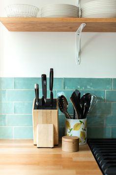 The backsplash is Catalina Green Lake ceramic tile from Home Depot.