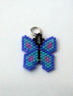 Butterfly Charm Made To Order Delica Beads by SmileykitCreations  (I'd request the butterfly in shades of purple)