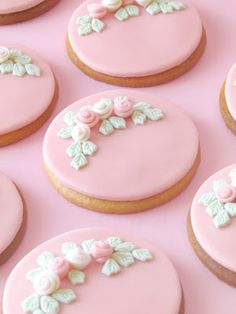 Pink Frosted cookies with rose buds