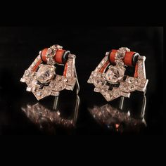CARTIER Paris.Art Deco 1937.Magnificent Diamond, Coral and Onyx  Dress Clips/Brooches...each design as an open geometric motif and set with a central old-cut diamond, surmounted by three further diamonds from a coral and black enamel barrel and surrounded by further diamonds with onyx accents Cartier, Paris 1937 - £100,000 to £250,000