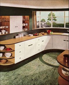 1937 Modern Kitchen. Elements that would still be relevant today include the sweeping curved counter, large window, &  detailed floor.