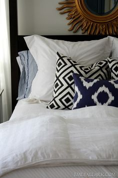 White bedding with blue accents.  Easy to change out and update.