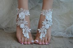 Barefoot sandals are the most practical wedding shoe option when having a beach wedding.Beach Wedding Barefoot Sandals are great for your unique wedding theme! Simple and sexy barefoot sandals but… Barefoot Sandals Wedding, Beach Wedding Shoes, Barefoot Beach, Beach Shoes, Hawaii Wedding, Beach Sandals, Wedding Jewelry, Navy Blue Sandals, Bride Shoes
