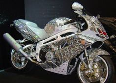 Saudi prince Al waleed bin talal owns an exclusive handmade diamond Ducati motorcycle, with cost estimated at about $4,800,000.00