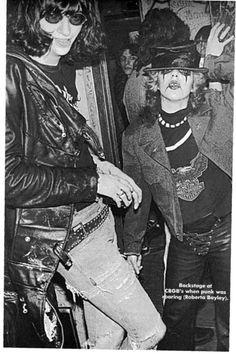 Ramones: Joey Ramone and fan at CBGB's, photo by Roberta Bayley, 1976
