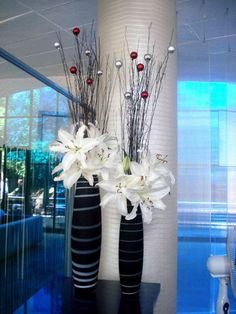 Try decorating your apartment with beautiful casablanca lilies and black willow for an elegant touch!