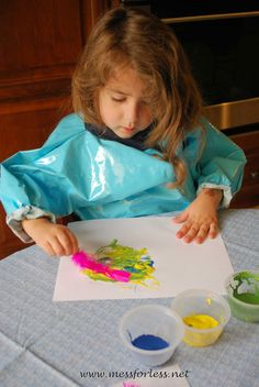 Painting with feathers make a great toddler and preschool art activity.
