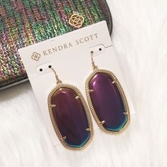 "NWT Kendra Scott Danielle Earrings! NWT Kendra Scott ""Danielle"" earrings. Never worn, on original earring card. Color: Black Iridescent. GORGEOUS and extremely popular--no lowballs if you make an offer! Approx. 1.9""L x 1""W. 14-karat gold-plated brass. Prong-set black iridescent glass centers. Wire backs. Imported. TRADES. Kendra Scott Jewelry Earrings"