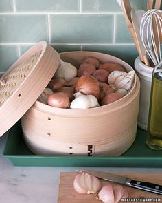 kitchen Storage Ideas: Because they're ventilated, Bamboo Steamers are great for storing onions, garlic and other items that shouldn't be refrigerated.