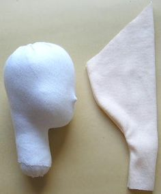 Sew up 4 pieces of the head.  Turn inside out.  Stuff polyester fiberfill solidly.  Stitch the end of the neck.  Stick a short applicator as the nose.  If there are crinkles on the seam, glue some cotton.  Cover the head with the under skin cloth.  Cover with skin cloth.  Paint features.  Put rouge on the cheeks.
