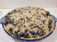 Fresh blueberry pie with graham cracker crust and crumb topping