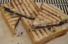 Chocolate and Cheese Sandwich: Bread slices sandwiched with a filling of grated chocolate and cheese and grilled to perfection.