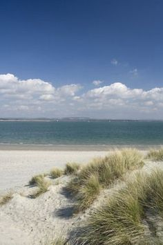 England Travel Inspiration - East Head, the dunes and wide sandy beaches at West Wittering on the eastern side of Chichester Harbour, West Sussex, UK