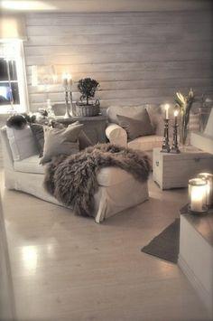 graue gestaltung vom  wohnzimmer - viele kerzen