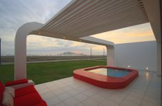 Jazzy Beach House in Breezy Look: Cozy Contemporary House In Palabritas Beach Outdoor Patio Completed With Red Sectional Sofa Situated Towar. Design Exterior, Interior Exterior, Interior Design, Outdoor Pergola, Outdoor Spaces, Outdoor Living, Red Sectional Sofa, Beach Properties, House Rooms