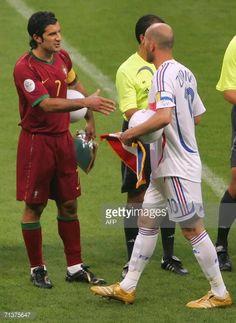 News Photo : France's Zinedine Zidane and Portugal's Luis Figo...