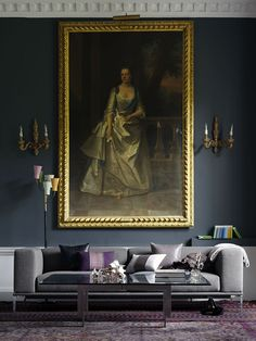 Modern and sleek coffee table, antique artwork and sconces.